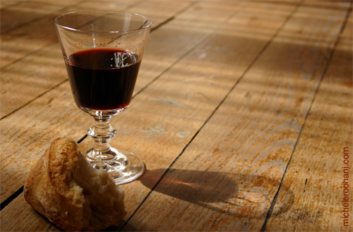 solitary wine glass on parquet bread michele roohani